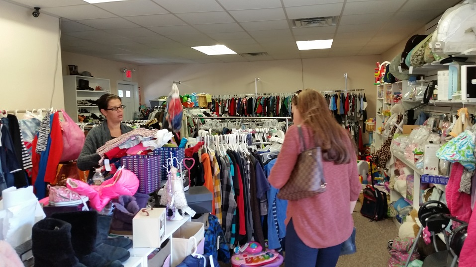 Customers search for children's clothing and other kid-friendly items selling for bargain prices.