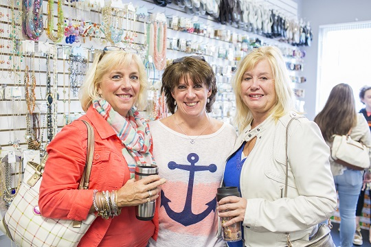 Karen Rennick, Tina Petrozino, and Verna Dresch shop around in Groovy Girls during Girls Weekend