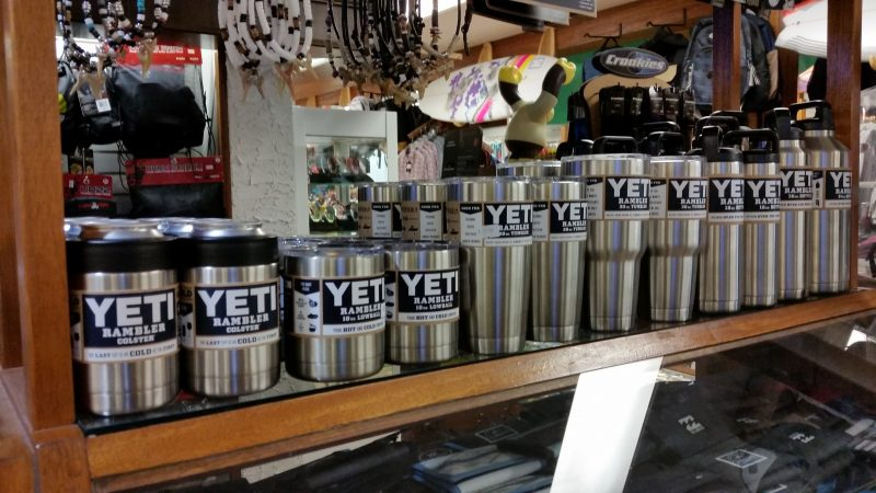 Yeti can holders and beverage containers are popular with commuters because they keep drinks cold or hot during long trips.